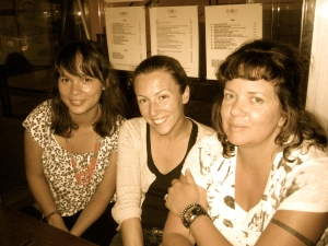 A photograph of Elizabeth, Charly and Candie at 3 Squares